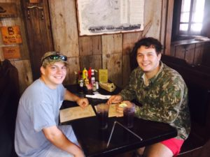 Brothers Tiff Lyons '19 and Barry Fontentot '19, unexpectedly encountered at Faunsdale Bar & Grill after a nearby turkey hunt on April 30, 2016. Photo courtesy of Lee Hurley.
